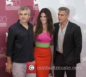 Alfonso Cuaron, George Clooney and Sandra Bullock - 70th Venice Film Festival - 'Gravity' - Photocall - Venice, Italy -...