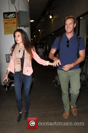 Armie Hammer and Elizabeth Chambers - Armie Hammer and Elizabeth Chambers arrive at LAX, Los Angeles International Airport, on an...