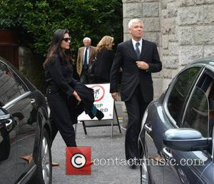 Mariana Teixeira and Adam Clayton - The funeral of poet Seamus Heaney at the Sacred Heart Church, Donnybrook - Dublin,...