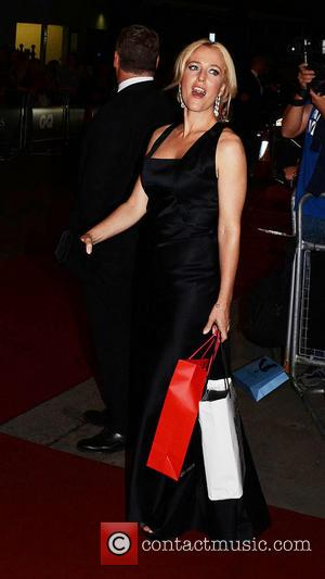Gillian Anderson - GQ Men of the Year Awards held at the Royal Opera House - Departures - London, United...