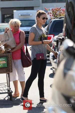 Mila Kunis - Mila Kunis shopping at Pavillions supermarket wearing a Batman T shirt - Los Angles, CA, United States...