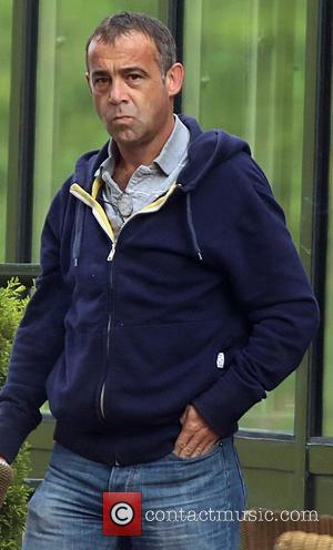 Michael Le Vell - Coronation street actor Michael Le Vell smokes a cigarette and talks to friends as he prepares...