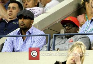 Boris Kodjoe and Cedric the Entertainer - Celebrities attend the 2013 US Open Tennis Championships game between Novak Djokovic and...