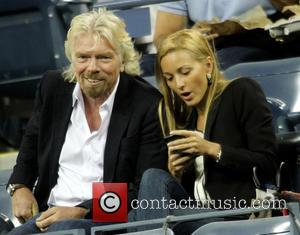 Richard Branson - Celebrities attend the 2013 US Open Tennis Championships game between Novak Djokovic and Mikhail Youzhny at the...