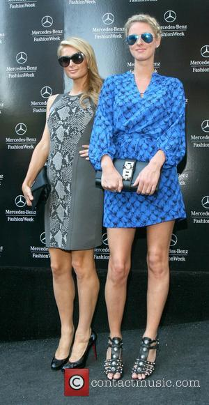 Paris Hilton and Nicky Hilton - Mercedes-Benz Fashion Week Spring 2014 at The Theatre, Lincoln Center - Diane Von Furstenberg...