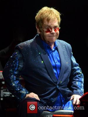 Elton John Donated Son's Christmas Presents To Orphanage