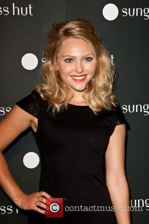 AnnaSophia Robb - The grand opening of Sunglass Nut's new Times Square store - New York City, NY, United States...