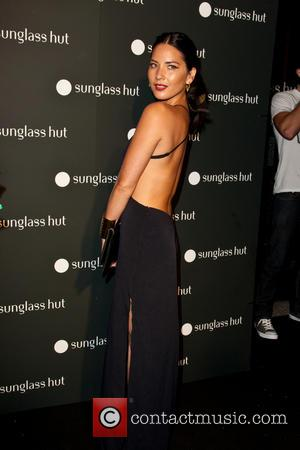 Olivia Munn - The grand opening of Sunglass Nut's new Times Square store - New York City, NY, United States...