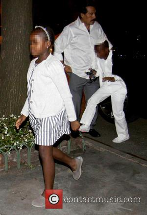 Mercy - Madonna and her children attend Yom Kippur services in Manhattan. The singer, who was covered up, was spotted...