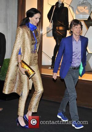 L'Wren Scott and Mick Jagger - Longchamp store opening held at Regent Street - Arrivals - London, United Kingdom -...