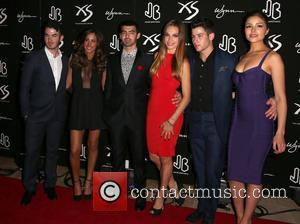 Kevin Jonas, Danielle Jonas, Joe Jonas, Blanda Eggenschwiler, Nick Jonas and Olivia Culpo