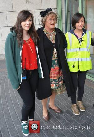 Brendan O'Carroll poses with Mrs Brown crew - Brendan O'Carroll's 'Mrs Brown's Boys D'Movie' shooting at Kevin Street DIT where...
