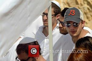 Ashton Kutcher And Mila Kunis Attend Funeral Of Kabbalah Leader