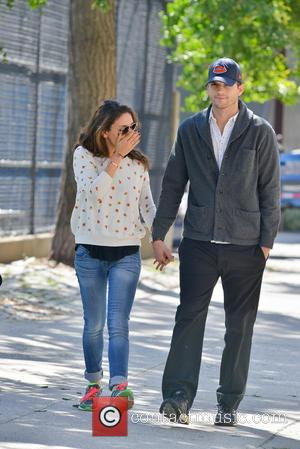 Ashton Kutcher and Mila Kunis - Ashton Kutcher and Mila Kunis taking a stroll in Soho - Manhattan, NY, United...