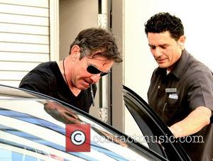 Dennis Quaid - Dennis Quaid leaving The Luxe Hotel in Beverly Hills sucking on a pen - Los Angeles, CA,...