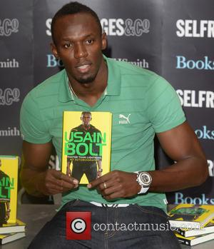 Usain Bolt - Usain Bolt signs his autobiography, Faster Than Lightning, at Selfridges. - London, United Kingdom - Thursday 19th...
