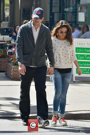 Ashton Kutcher and Mila Kunis - Ashton Kutcher and Mila Kunis taking a stroll in Soho - Manhattan, New York,...