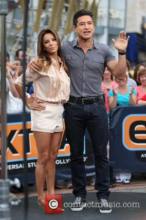 Eva Longoria and Mario Lopez - Eva Longoria appears on the Extra TV show hosted by Mario Lopez. - Los...
