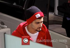 Zayn Malik - One Direction leave the UK and travel light as they fly to Australia to start the Southern...