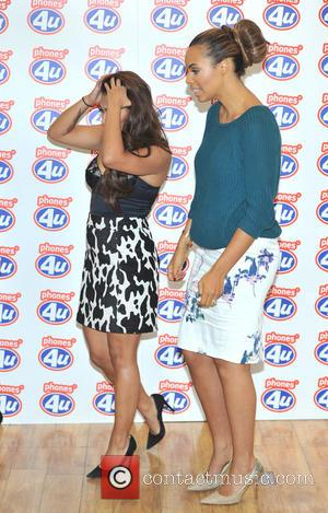 Rochelle Humes and Vanessa White - Una Healy, Vanessa White and Rochelle Humes of The Saturdays visit the Phones 4U...