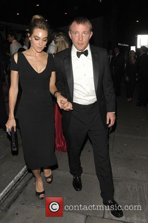 Guy Ritchie and Jacqui Ainsley - Boodles Boxing Ball 2013 held at Grosvenor House - Arrivals - London, United Kingdom...