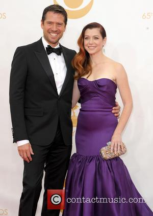 Alyson Hannigan and Alexis Deniso - 65th Annual Primetime Emmy Awards held at Nokia Theatre L.A. Live - Arrivals -...