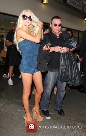 Courtney Stodden and Doug Hutchison - Courtney Stodden and Doug Hutchison at Los Angeles International Airport, LAX, on a Virgin...
