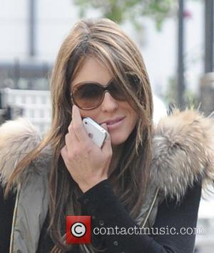 Liz Hurley and Elizabeth Hurley - The engagement ring is still missing from Liz Hurley's finger as she is seen...