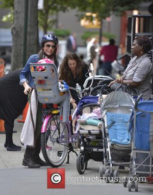 Bethany Frankel - Bethany Frankel picks Bryne up from school on a bike - Manhattan, NY, United States - Wednesday...