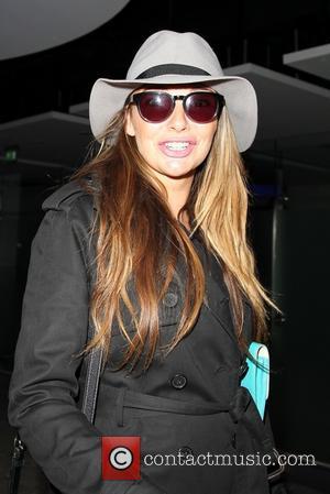 Nadine Coyle - Pregnant Nadine Coyle arrives in London with her partner Jason Bell. - London, United Kingdom - Friday...