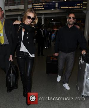 Jason Statham and Rosie Huntington-Whiteley - Rosie Huntington Whitely and Jason Statham seen at kings cross st pancras - London,...