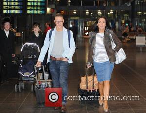Susanna Reid and Kevin Clifton - Fresh faced Susanna Reid and dance partner Kevin Clifton arrive in Manchester by train....