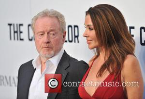 Ridley Scott and Guest - The Counsellor Special Screening held at the Odeon West End - Arrivals. - London, United...