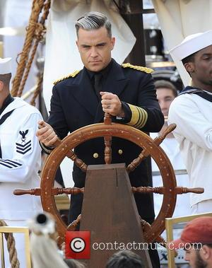 Robbie Williams - Robbie Williams filming a music video for his song 'Go Gentle' off his upcoming album 'Swings Both...