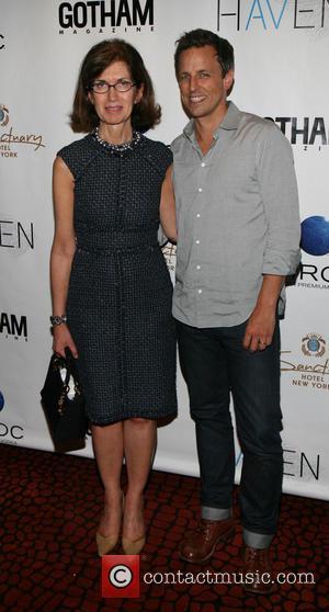 Catherine Sabino and Seth Meyers