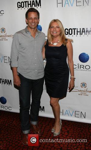Seth Meyers and Debra Halpert