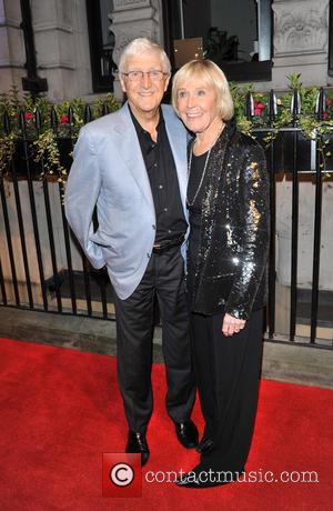 Michael Parkinson and Guest - The BFI Luminous gala dinner & auction held at 8 Northumberland Avenue - Arrivals -...