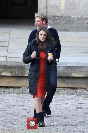 Elizabeth Hurley and Shane Warne - Filming on the set of 'The Royals' for E! network. Elizabeth Hurley, who plays...