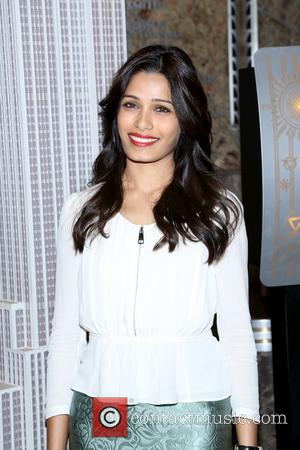 Freida Pinto - Freida Pinto illumintes the Empire State Building - New York, NY, United States - Thursday 10th October...