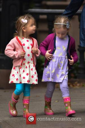 Tabitha and Marion - Matthew Broderick takes his children to school on a rainy day in Manhattan - New York...