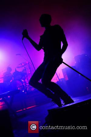 Editors - Singer Tom Smith of the Editors performs live during a concert at the Alcatraz on October 10, 2013...