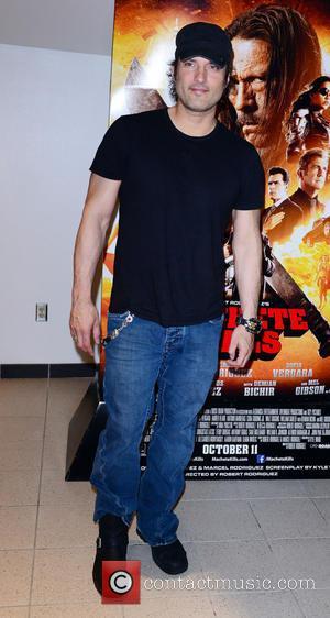 Robert Rodriguez - Premiere of 'Machete Kills' held at the Regal South Beach Cinema - Arrivals - Miami Beach, Florida,...