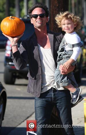 Walton Goggins and Augustus Goggins - Celebrities visit Mr Bones Pumpkin Patch with their children - Los Angeles, California, United...