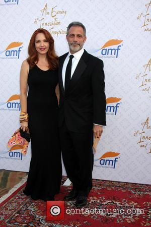 Amy Yasbeck and Michael Plonsker - 10th Alfred Mann Foundation Gala held at the Robinson-May lot in Beverly Hills, CA....