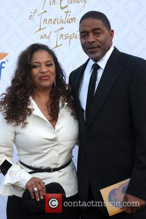 Debbie Allen and Norm Nixon - 10th Alfred Mann Foundation Gala held at the Robinson-May lot in Beverly Hills, CA....