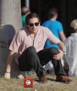 Jake Gyllenhaal - Jake Gyllenhaal looking slim as he filmed a scene on Venice Beach for his new movie Nightcrawler,...