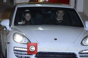 Michelle Hunziker - Michelle Hunziker arrives in a white Porsche Cayenne on her first day of work after childbirth -...