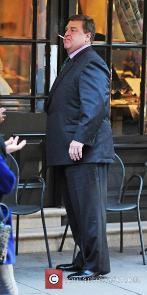John Goodman - American actor John Goodman smokes a cigarette outside a hotel in London - London, United Kingdom -...
