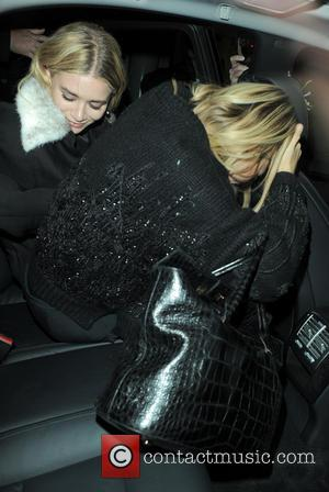Mary-Kate Olsen and Ashley Olsen - Twins Mary-Kate Olsen and Ashley Olsen leave The Arts Club and then headed for...