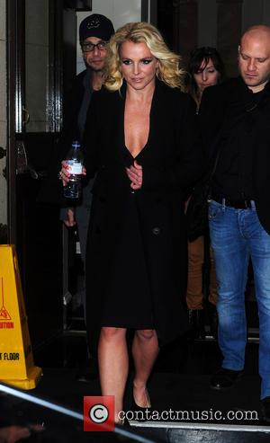BRITNEY SPEARS - BRITNEY SPEARS DEPARTS HER LONDON HOTEL , IN A REVEALING BLACK OUTFIT . BRITNEY IS SCHEDULED TO...